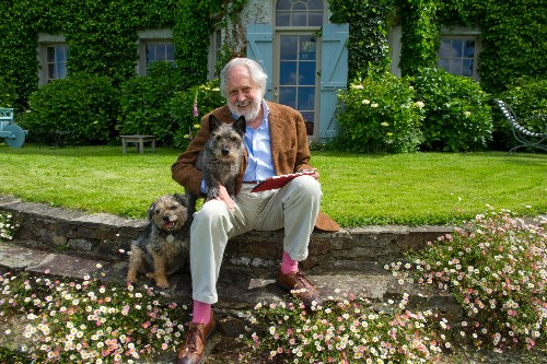David and dogs outside his beautiful home River House